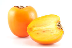 Orange persimmon with sliced one Stock Photography