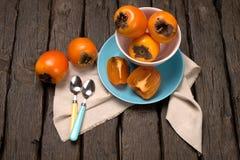 Orange persimmons Stock Photos