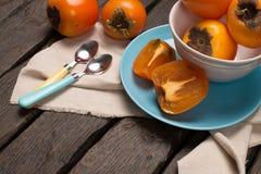 Orange persimmons Stock Images