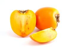 Orange Persimone mit geschnittener Stockfotos
