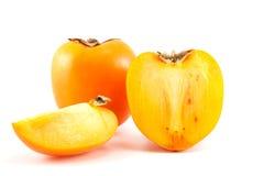 Orange Persimone mit Scheiben Lizenzfreie Stockfotografie