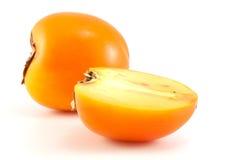 Orange Persimone mit Scheiben Stockbild