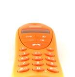 Orange phone. An isolated orange phone on a white background Stock Photos