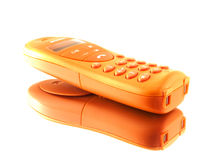 Orange phone on a mirror. An isolated orange handphone on a mirror royalty free stock photography