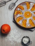 Orange pie and ingredients stock photography