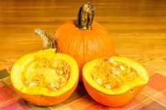 Orange pie pumpkin cut in half Stock Photography