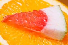 Orange and piece of grapefruit. Royalty Free Stock Image