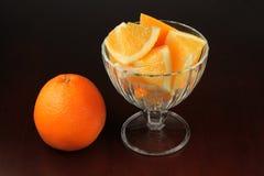 Orange pieces on black Stock Photo