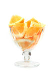 Orange pieces in bowl isolated Royalty Free Stock Images