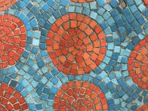 Orange and blue pieces of square mosaic created as amazing pattern royalty free stock photo