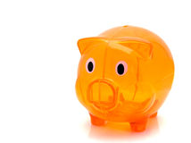 Orange piggy bank Stock Images