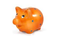 Orange piggy bank isolated on white Stock Images