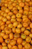 Orange pile. Pile of oranges at the market. Some of them are deteriorated Stock Photo