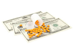 Orange pill at the money Royalty Free Stock Photos
