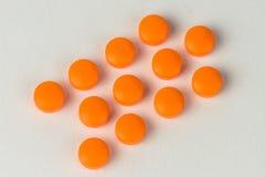 Orange Pillen stockbilder