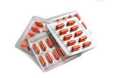 Orange Pillenkapseln in den Blisterpackungen Lizenzfreies Stockfoto