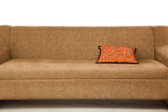 Orange pillow on a sofa Stock Photography