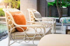 Orange pillow on wooden chair Royalty Free Stock Photography
