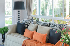 Orange pillows and blanket on classic sofa in living room Stock Photos