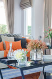 Orange pillows and blanket on modern sofa in living room. At home Stock Photos