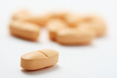 Orange pills Royalty Free Stock Photography