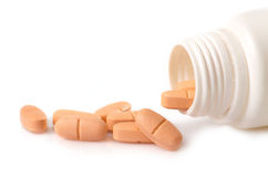 Orange pills Royalty Free Stock Photos