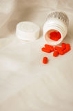 Orange pills Royalty Free Stock Image
