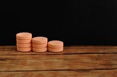 Orange pills. Isolated on a black background Stock Image