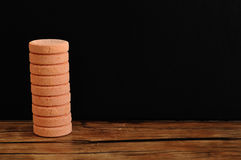 Orange pills. Isolated on a black background Stock Images