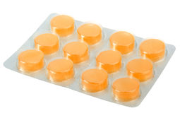 Orange pills in metallic blister Royalty Free Stock Photography