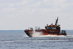 Orange pilot boat Stock Photos