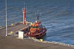 Orange Pilot boat in harbour Stock Photography