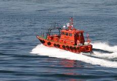Orange pilot boat. Navigating the sea Stock Photos