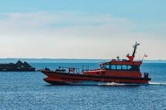 Orange pilot ship Stock Image
