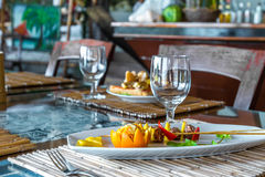 Orange and pineapple appetizer on plate in restaurant or Stock Image