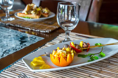 Orange and pineapple appetizer on plate in restaurant or Stock Photos