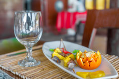 Orange and pineapple appetizer on plate in restaurant or Stock Images