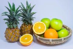 Orange pineapple apple fruit isolated on white background Stock Photo