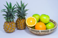Orange pineapple apple fruit isolated on white background Stock Images