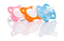 Orange, Pink And Blue Pacifier II Royalty Free Stock Photos