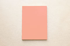 Blank orange pink book cover with paper texture background Royalty Free Stock Photography