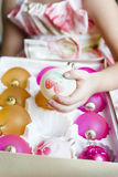 Orange and pink Christmas balls in a box close-up Royalty Free Stock Photography