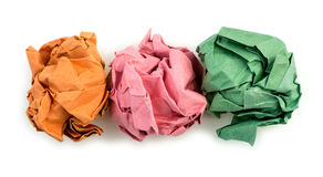 Orange, pink and green creased folded paper balls Stock Image