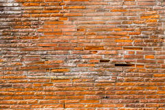 Orange pink old thin bricks work wall. Backgrounds full frame. Orange pink old grunge thin bricks work wall. Backgrounds full frame composition Royalty Free Stock Photography