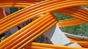 Orange pipes for fiber optic connection ADSL users Stock Image