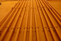 Orange piping Industrial background. Tubes, may be used as industrial background Stock Images