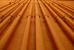 Orange piping Industrial background Royalty Free Stock Photography