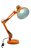 Orange Pixar Lamp. An isolated picture of a orange pixar lamp with power cord and switch. A fluorescent daylight bulb is installed and is powered (lit) on Royalty Free Stock Photo
