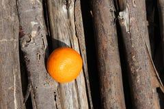 Orange placed on wood Stock Photos