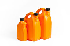 Orange plast- bensindunkar arkivfoto